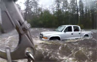 Rescue Swimmer Investigates Truck in Dangerous Flooding