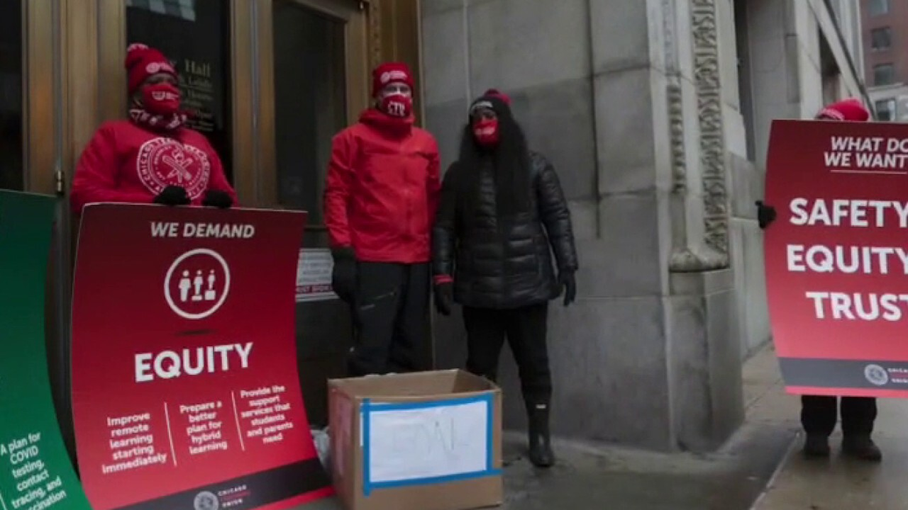 Chicago teachers stage walkout, demand deal on school reopening