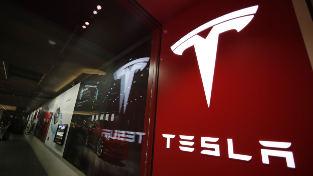 Tesla predicted to report strong quarterly earnings