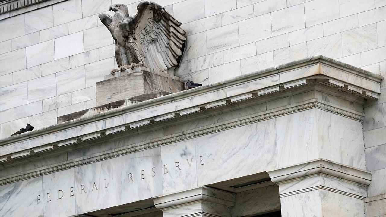 Fed maintains near-zero rates