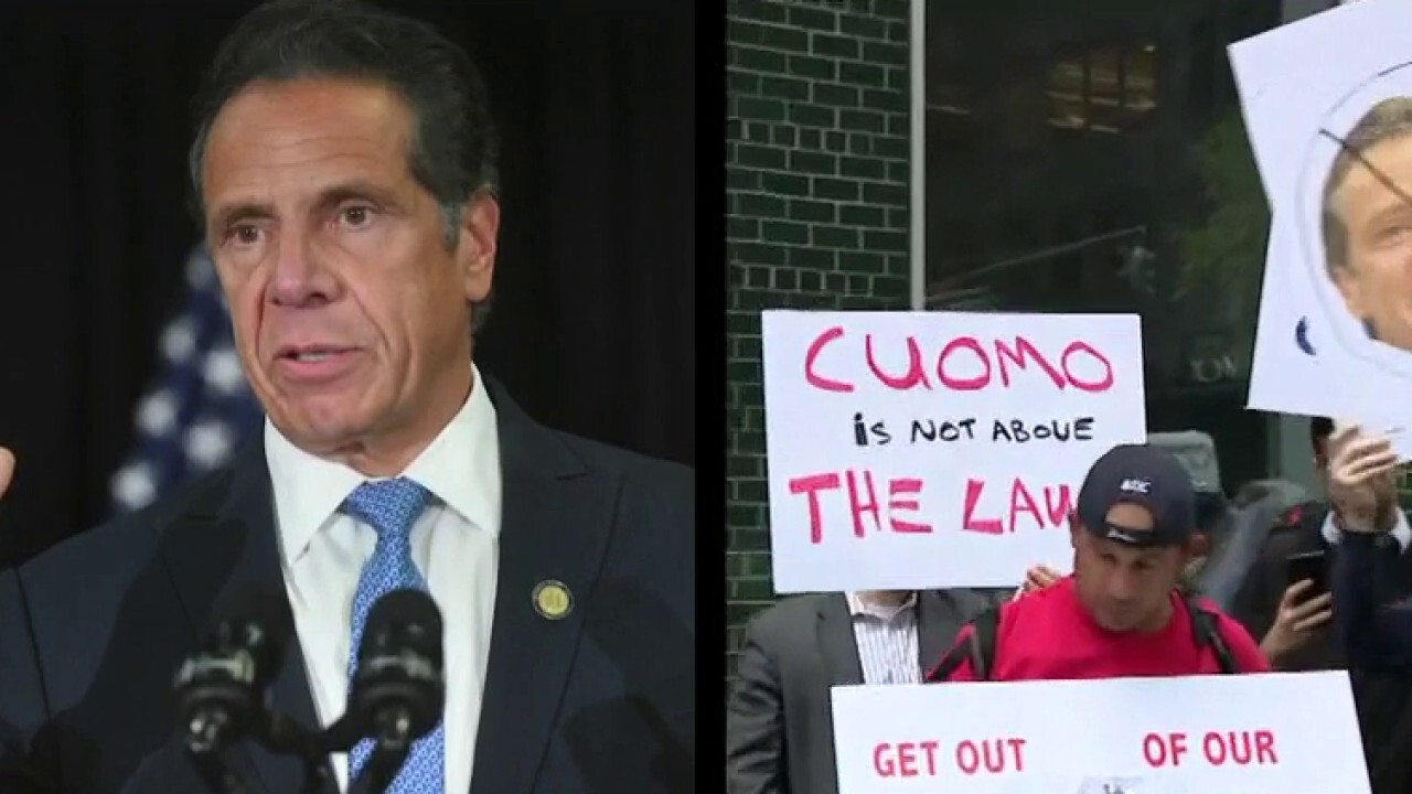 Protests grow outside Cuomo's office after 'stunning' sexual harassment report