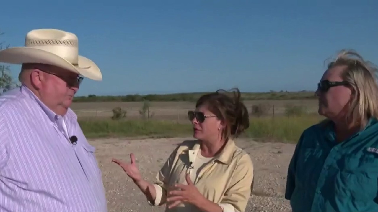 Texas ranchers John Paul and Donna Schuster discuss the overwhelming migrant surge, damage done to their property and why they started carrying guns during an emotional interview with FOX Business' Maria Bartiromo.