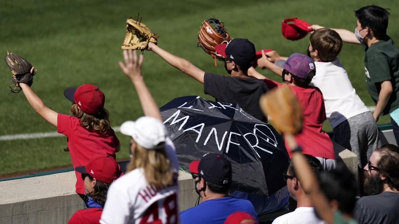 MLB commissioner Manfred faced pressure to endorse progressive voting laws: Sources