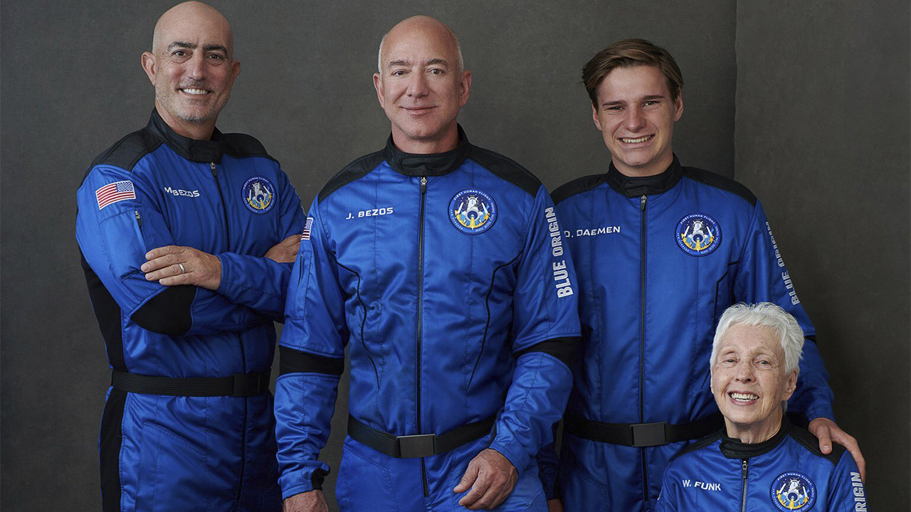 Jeff Bezos and his Blue Origin crew hold post-mission press conference.