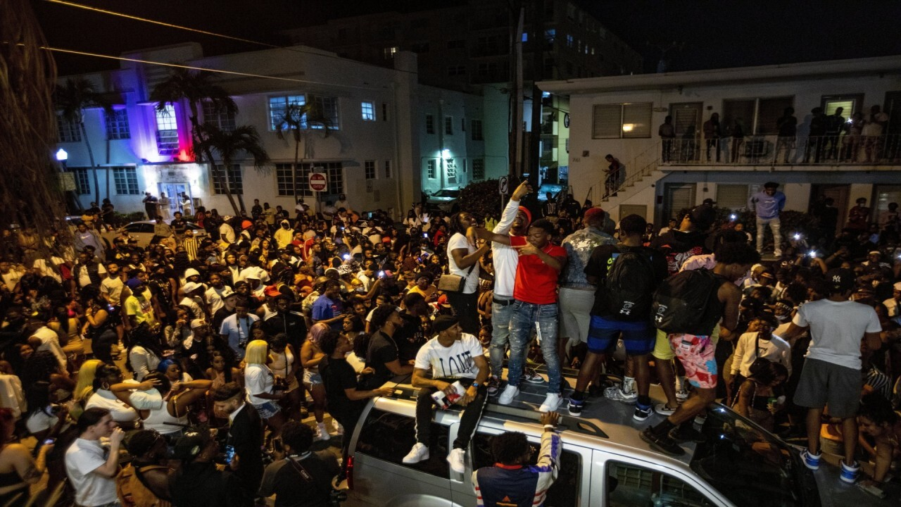 Miami Beach Mayor Dan Gelber says at night the small entertainment district in the area turned into what felt like a 'rock concert' with a lot of people crowded together causing a 'dangerous' situation.